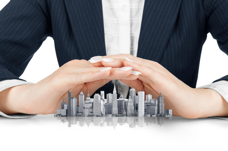Female hands saving small city with a roof stock images