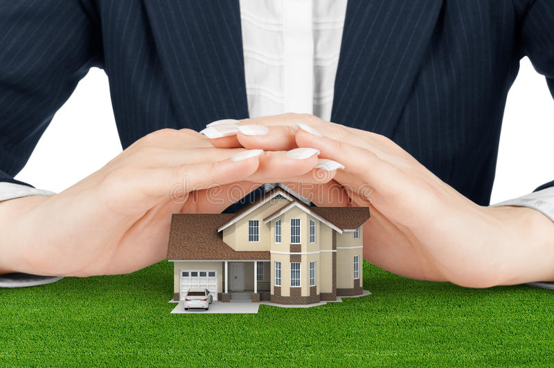 Female hands saving small house with a roof royalty free stock images