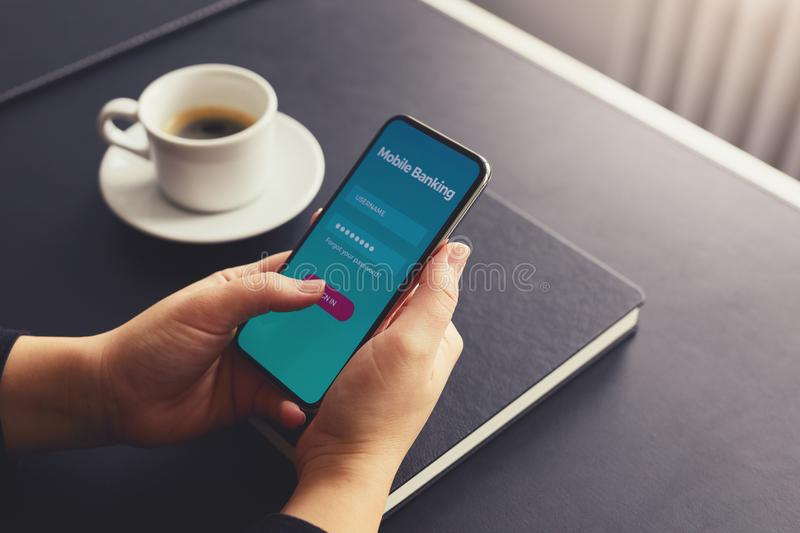 Female hands sign up for banking with a mobile phone royalty free stock photo