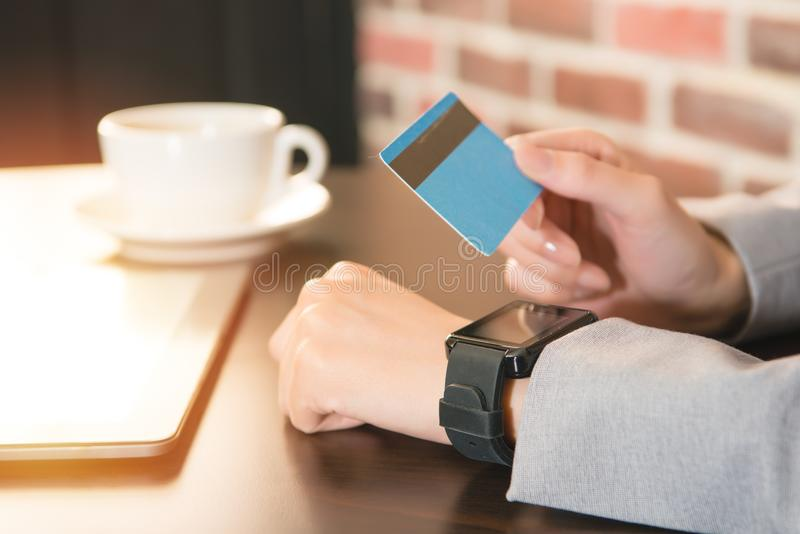 Female hands smart watch and credit card. Business technology cash free and internet people concept close up of female hands with smart watch and credit card at stock photo