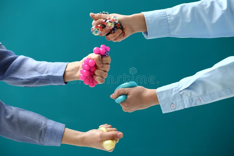 Female hands squeezing stress balls on color background royalty free stock image