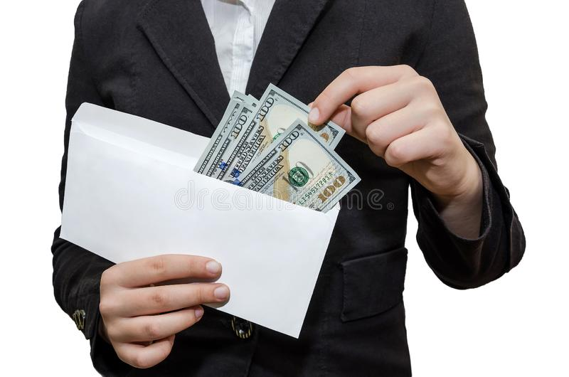 Female hands take out dollars from a white envelope. White background. Hands take out dollars from a white envelope. White background stock photo