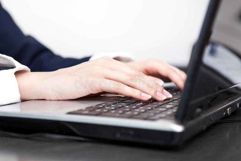 Female hands typing stock images