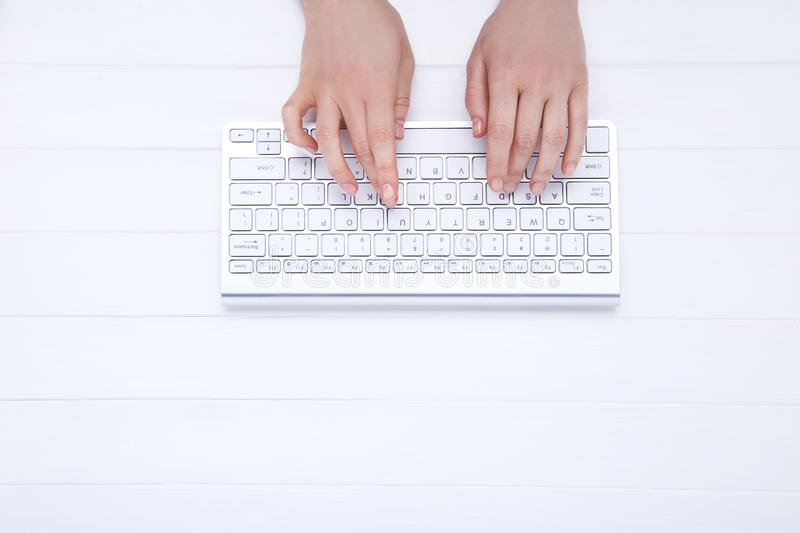 Hands typing on keyboard royalty free stock photo