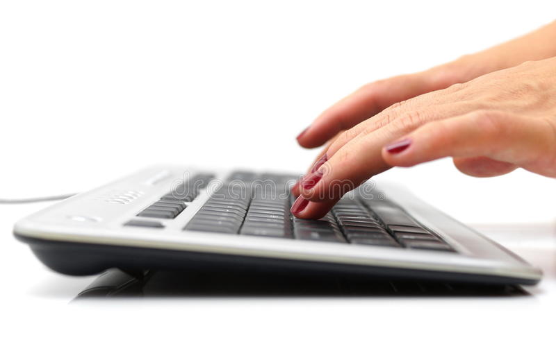 Female hands typing on keyboard stock photos