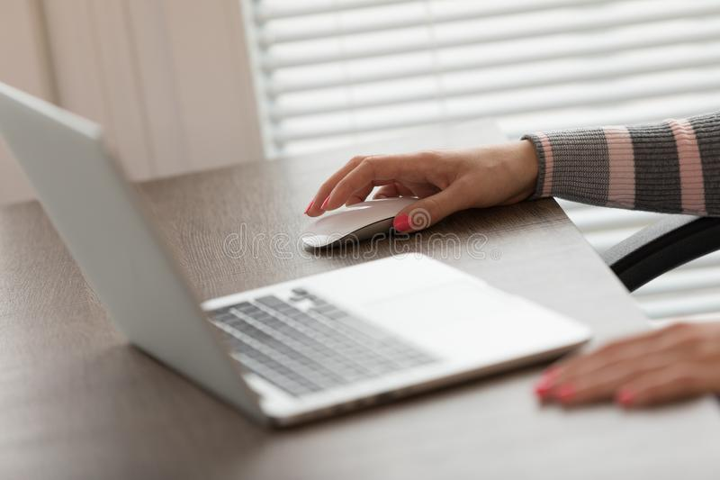 Female hands using laptop at desk royalty free stock photography