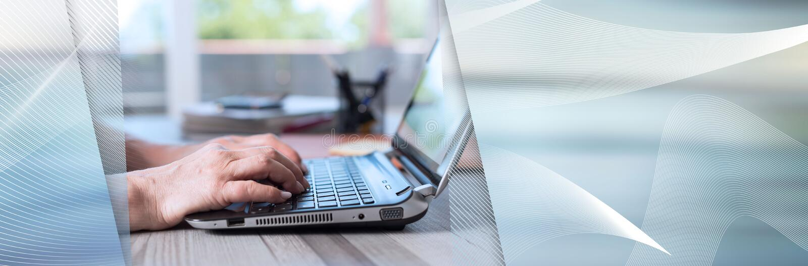 Female hands using a laptop. panoramic banner. Female hands using a laptop in office. panoramic banner royalty free stock photos