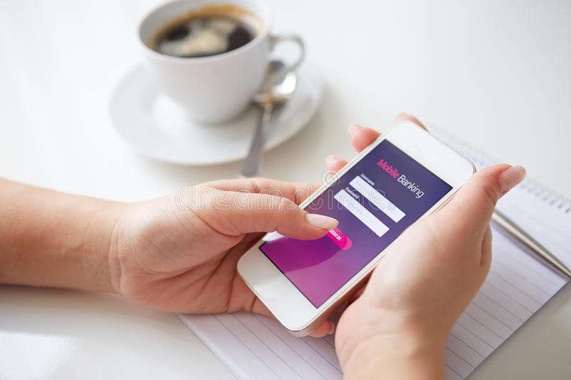 Female hands using mobile banking. On white smartphone stock images
