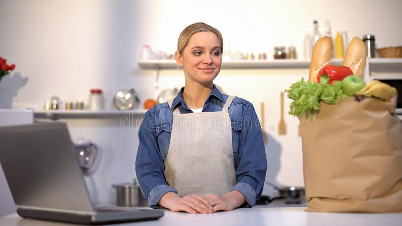 Female happy with purchase of groceries over internet, online food order service. Stock photo stock image