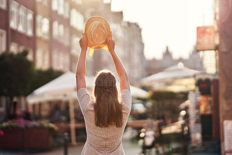Female happy tourist sightseeing Gdansk Poland in summer royalty free stock image