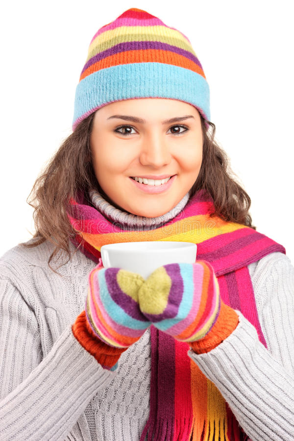 Female With Hat And Scarf And Holding A Cup Of Tea Royalty Free Stock Photos
