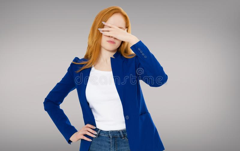 Female headache isolated on gray background - suffering business woman, hard work in company royalty free stock photo