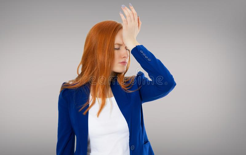 Female headache isolated on gray background - suffering business woman, hard work in company royalty free stock photos