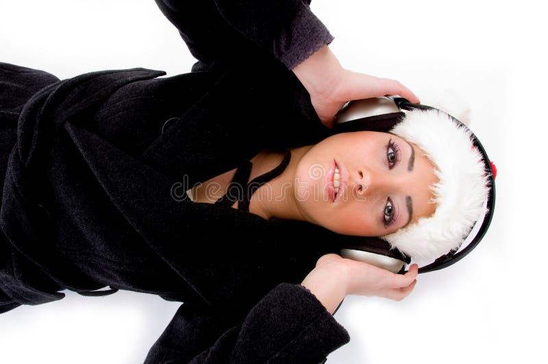 female headphone listening lying music royaltyfri foto