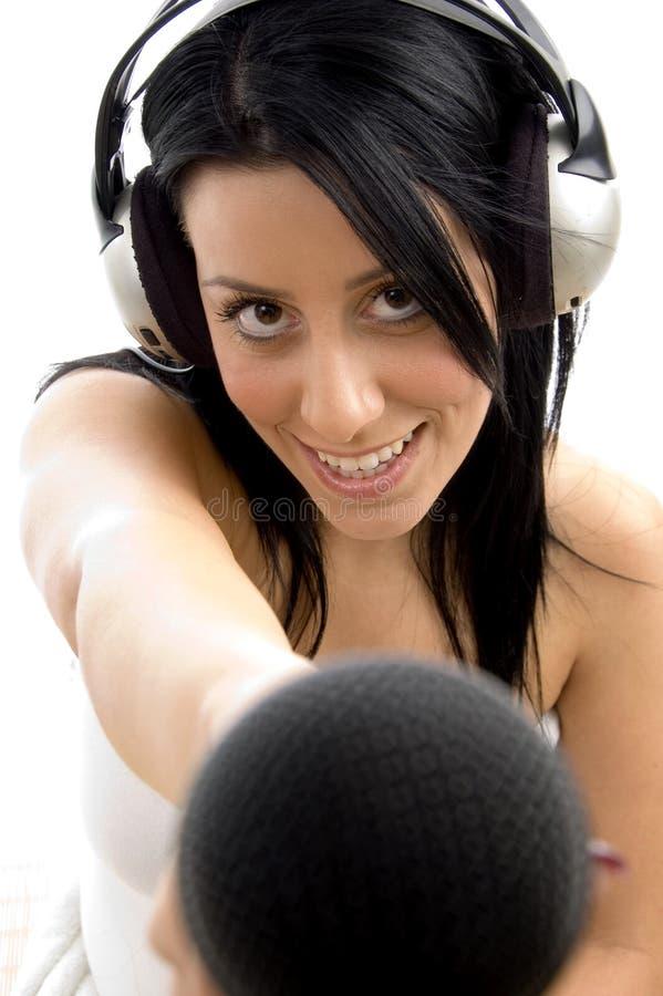 female headphone microphone posing στοκ φωτογραφία με δικαίωμα ελεύθερης χρήσης