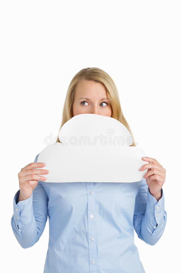 Female hiding behind a paper cloud stock photo