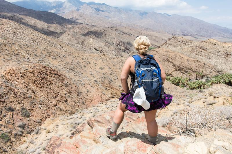 A female hiker, hiking in the Indian Canyons in Palm Springs California on a cliff. A female hiker, hiking in the Indian Canyons in Palm Springs California stock photo