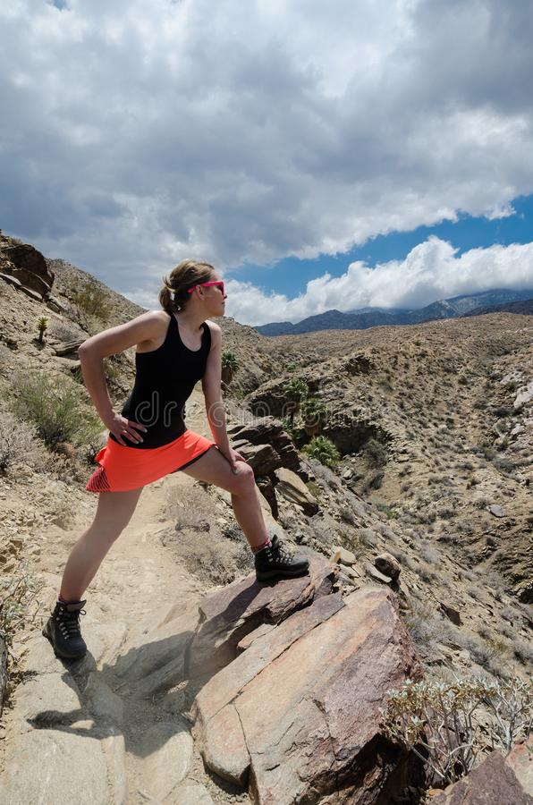 A female hiker, hiking in the Indian Canyons in Palm Springs California looks out into the vast desert royalty free stock photo