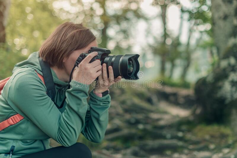 Female hiker photographing nature landscape stock images