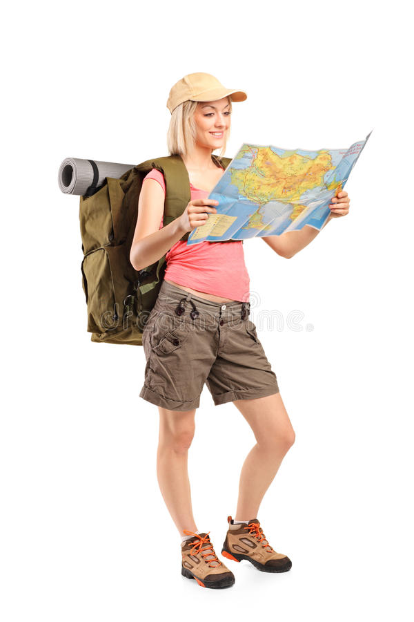 Download Female Hiker Looking At Map Stock Photo - Image: 20631050