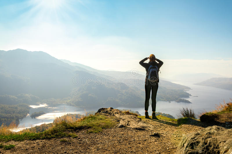 Female hiker on top of the mountain enjoying valley view stock photos