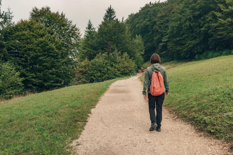 Female hiker walking on footpath outdoors royalty free stock images