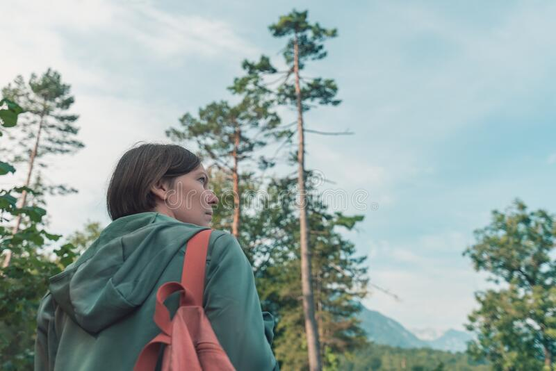 Female hiker walking outdoors in woods royalty free stock photo