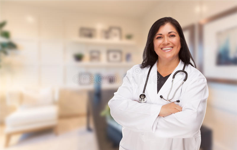 Female Hispanic Doctor or Nurse Standing in Her Office.  stock photos