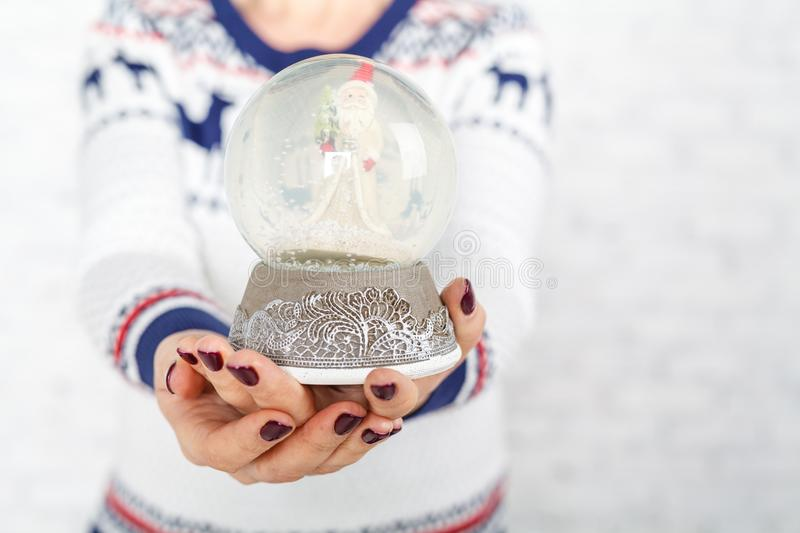 Female hold chistmas decoration and give it stock photo