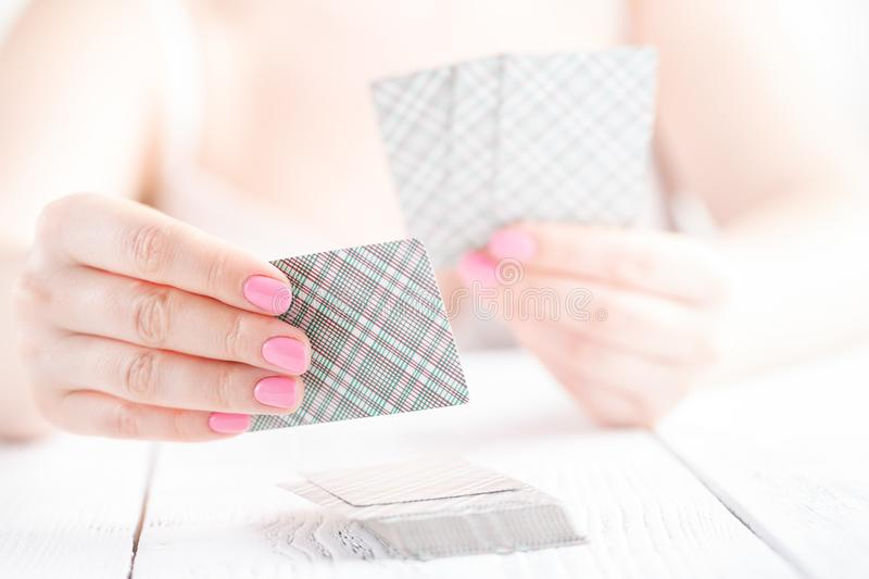 Female hold few playing cards with cover stock image
