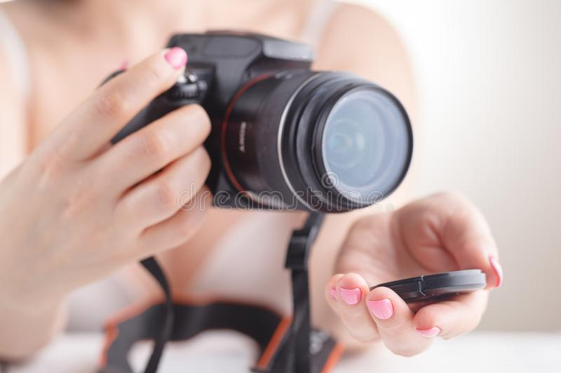 Female hold SLR photo camera in hands stock photo