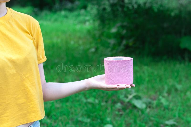 Female Hold toilet paper outdur nature. Concept of diarrhea in summer season royalty free stock photos
