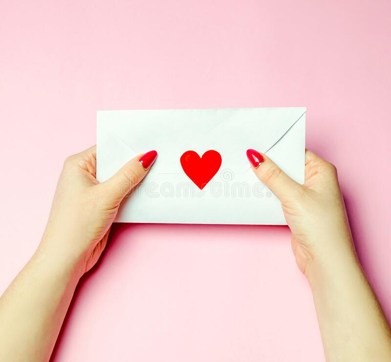 Free Female Holding An Envelope With A Red Heart. Valentines Day Concept. A Love Letter To The Beloved. Greeting Valentine Card. Royalty Free Stock Photo - 172242975