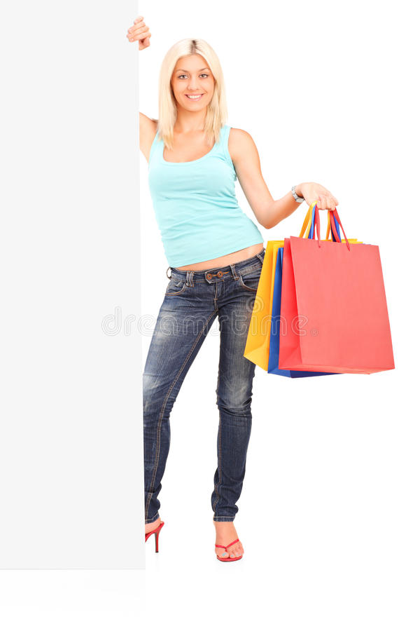 Download Female Holding Bags And Standing Next To A Panel Stock Photo - Image of gift, billboard: 26100828