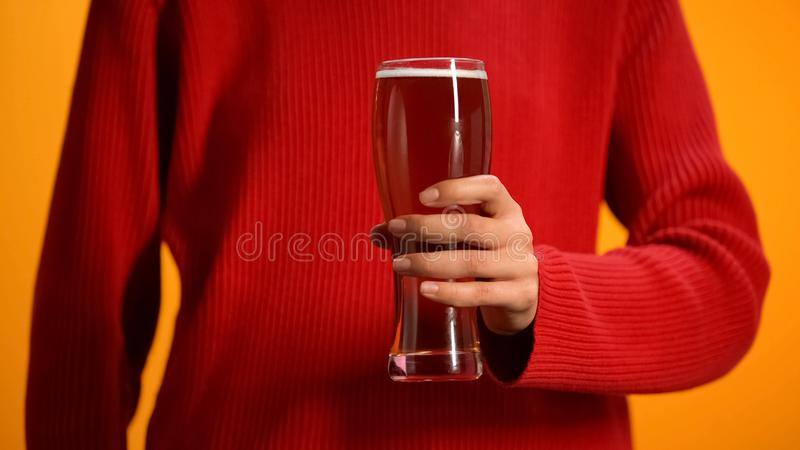 Female holding beer glass, drunk driving danger, women alcohol addiction stock image
