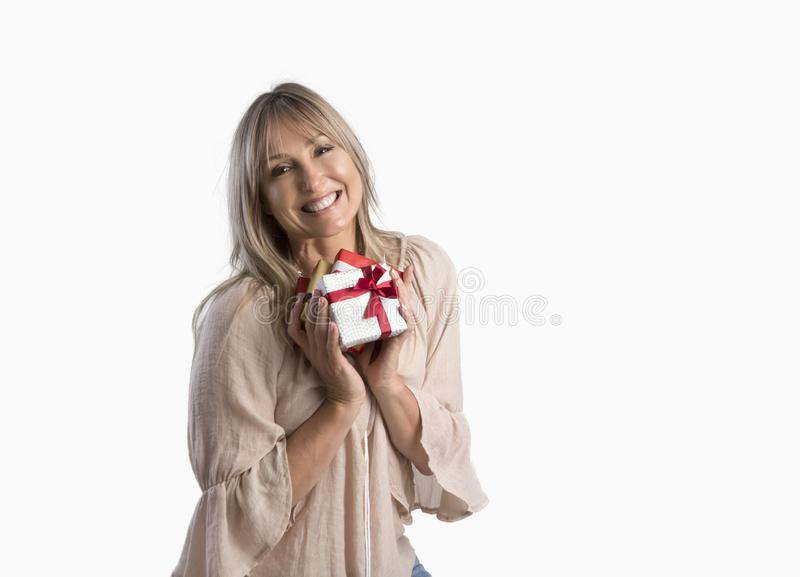 Female holding birthday or Christmas presents stock photos