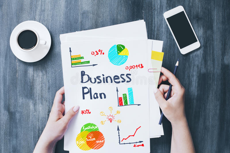 Female holding business plan stock photo