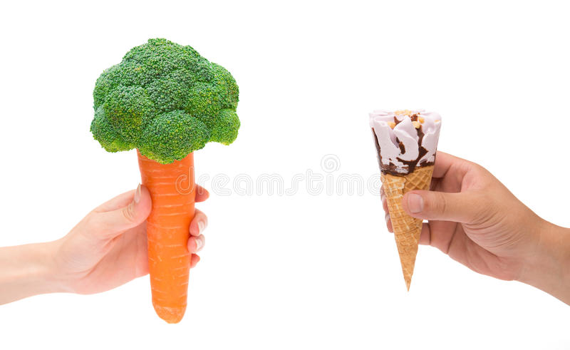 Female holding carrot with cauliflower and male holding ice cream cone on white with clipping path stock images