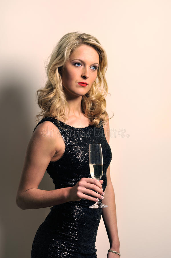 Female holding a champagne flute stock photos