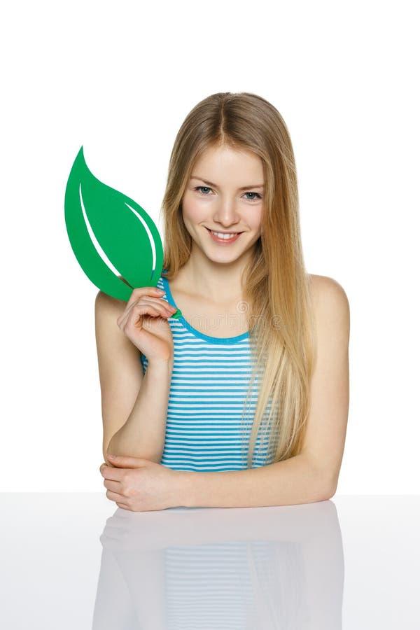 Female holding eco symbol leaf stock photography
