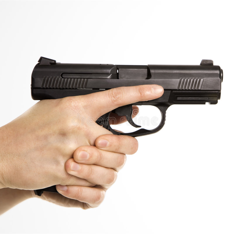 Female holding handgun. Close up of mid adult female Caucasian law enforcement officer hands on gun aiming royalty free stock images