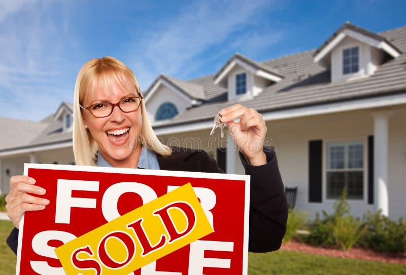 Female Holding Keys & Sold Real Estate Sign stock image
