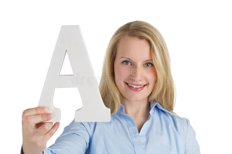 Female holding the letter A royalty free stock photography
