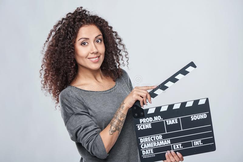Female holding movie clapper board royalty free stock image