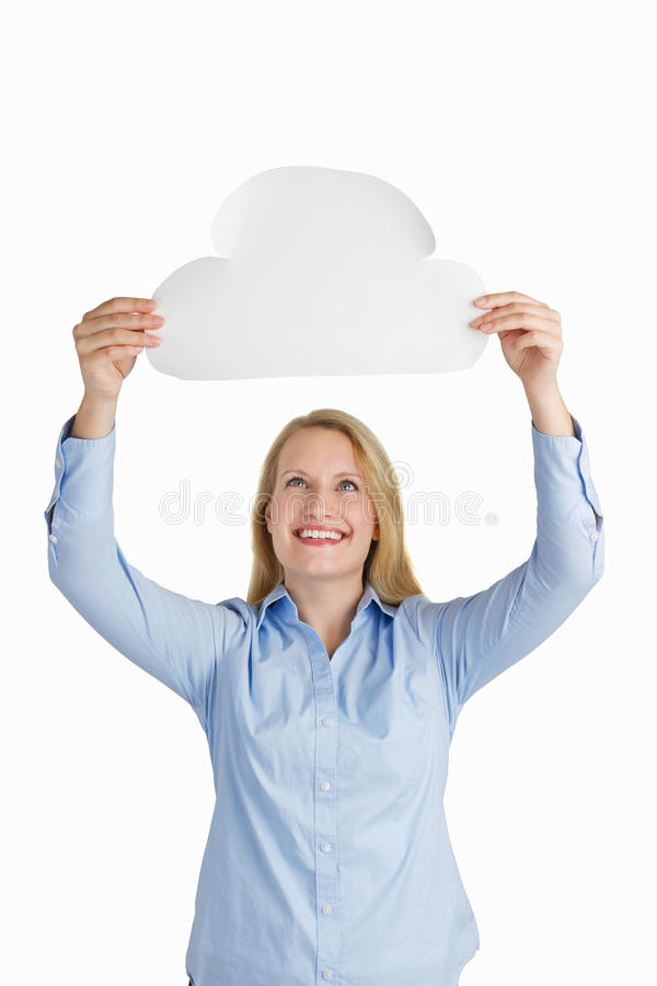 Female holding a paper cloud and smiling stock image