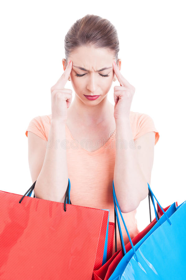 Female holding shopping bags feeling headache stress or pain. Isolated on white background stock image