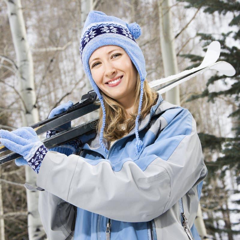 Female holding skis. stock photo