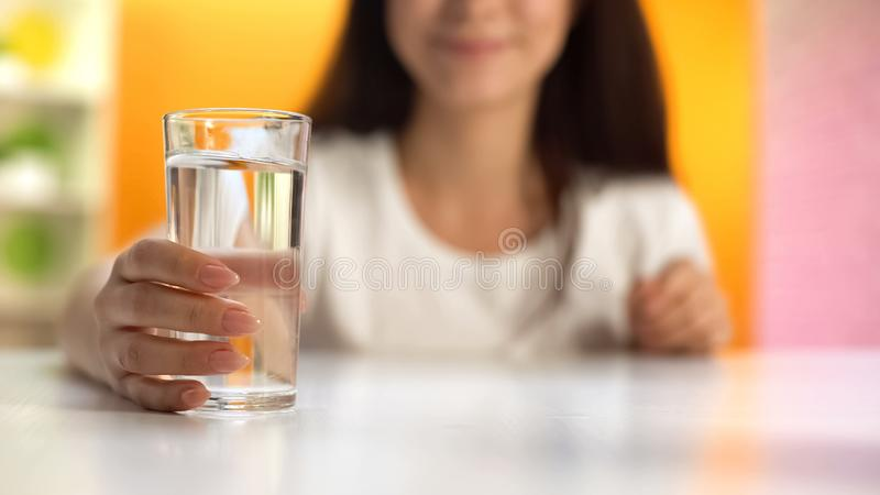 Female holding water glass, health care, body hydration, slimming and dieting. Stock photo stock photo