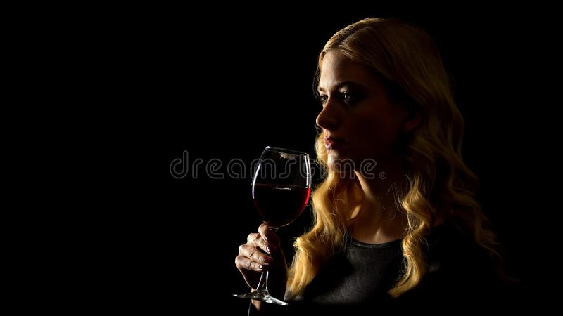 Female holding wine glass, harmful effect of alcohol on women health, addiction royalty free stock photo