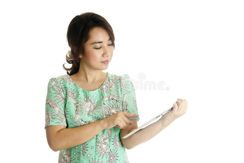 Female holds and touch tablet computer